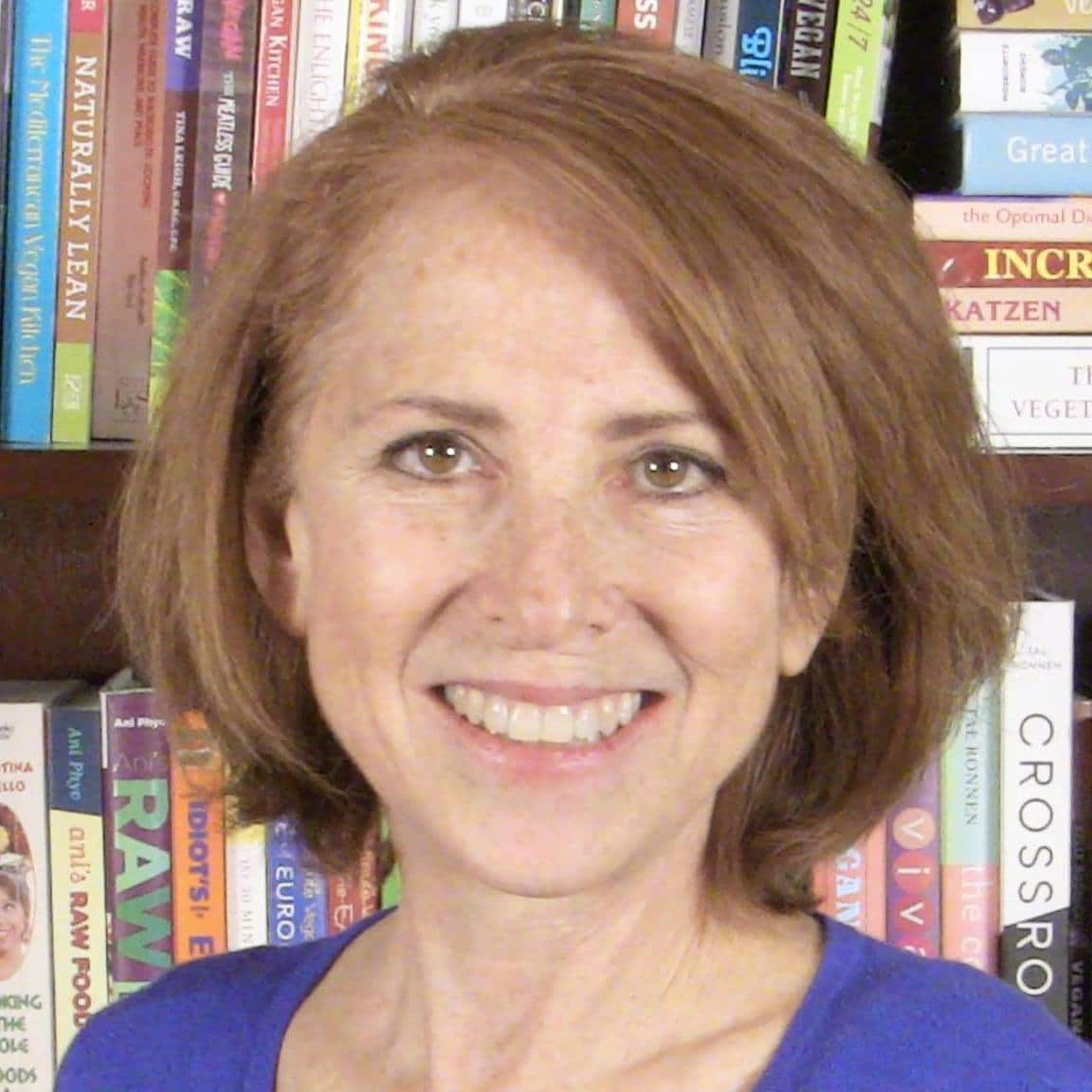 caryn-hartglass-with-books.jpg